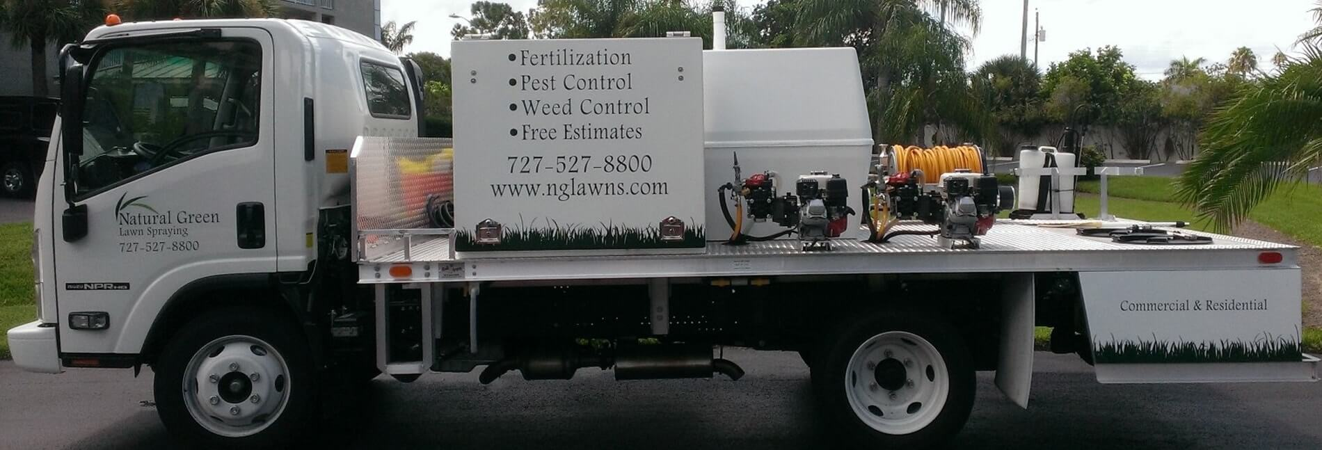 lawn spraying work truck with equipment
